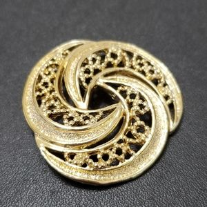 Gerry's gold tone swirl brooch